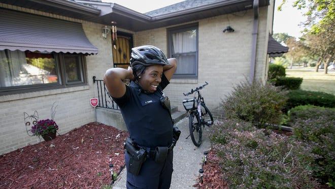 Rockford police officer Patrice Turner gets ready to patrol the neighborhood around her Winnebago Street home on Wednesday, Sept. 13, 2017.