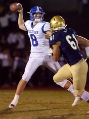 .Middletown quarterback Drew Fry throws as Salesianum's Casey Spink defends in the first quarter at Baynard Stadium Friday.