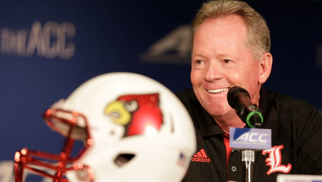 Louisville head coach Bobby Petrino answers a question during his news conference Monday at the ACC Kickoff in Greensboro, N.C.