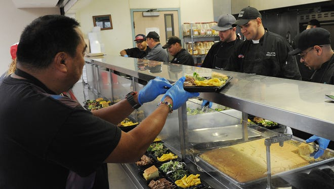 In this file photo, Preci Pamomares, left, and other residents in the Culinary Arts Vocational Training Program at the Ventura County Rescue Mission prepare and serve lunches to community members and other residents.