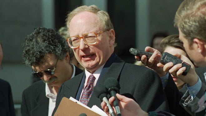 Stephen Jones, attorney for Oklahoma City bomber Timothy McVeigh, talks to reporters in front of the United States Courthouse in downtown Denver on Feb. 18, 1997.