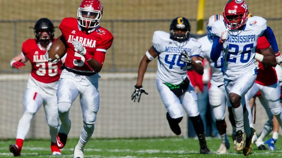 Alabama All Star Henry Ruggs, III of R. E. Lee, returns a kick off for a touchdown during the Alabama vs. Mississippi All-Star high school football game at the Cramton Bowl in Montgomery, Ala., on Saturday, Dec. 10, 2016.