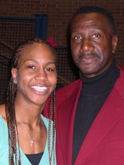 Tamika Catchings and her father, Harvey Catchings,