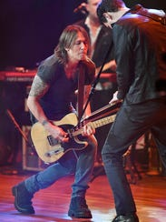 Keith Urban will debut a song inspired by the Harvey Weinstein scandal at Wednesday's CMA Awards in Nashville.