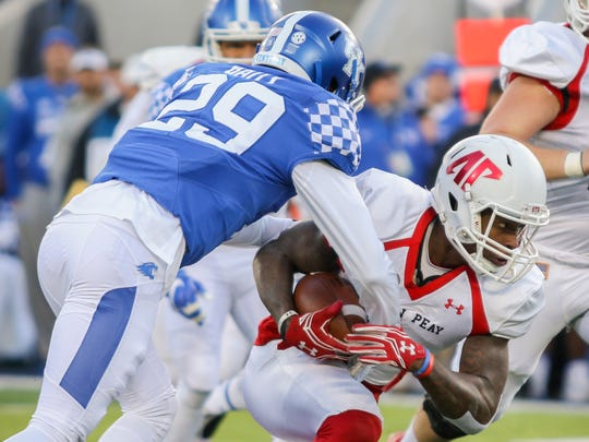 Austin Peay junior Jared Beard (1) tries to gain yards after a reception during their game against Kentucky at Commonwealth Stadium on Saturday. Austin Peay lost the game 49-13.