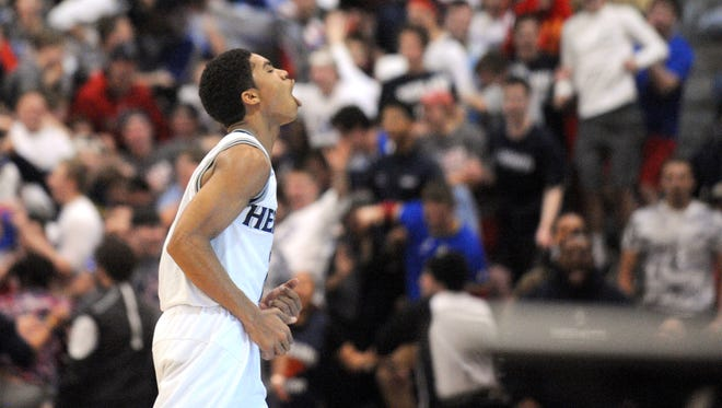St. Augustine's Sa'eed Nelson reacts after hitting a beyond half-court shot to end the first half during Saturday's Non-Public A boys basketball final against Don Bosco Prep at Pine Belt Arena in Toms River. 3.12.15.