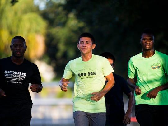 Jose Reza, 19, center, runs with Andonet Thermidor,