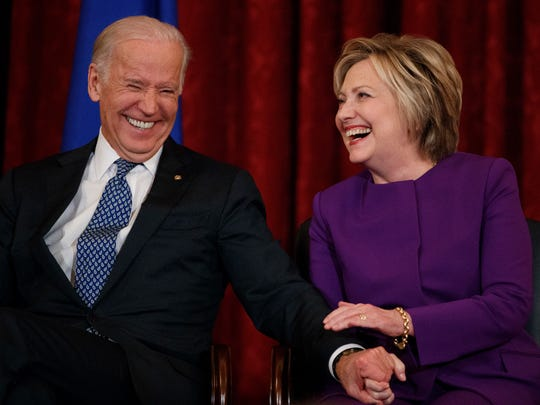 Vice President Joe Biden laughs with former Secretary of State Hillary Clinton in 2016.
