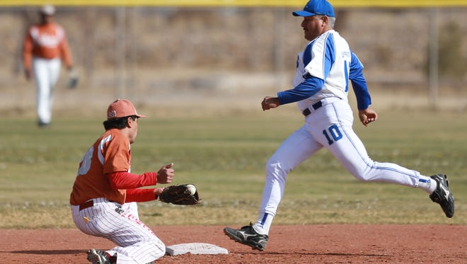 Ramon Serna of the Rays heads to second base as Cruz Arciniega was unable to handle a throw during a recent  International 50 and Over Baseball Association game.