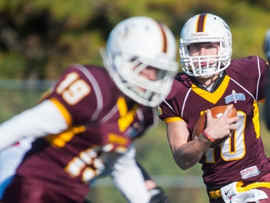 Salisbury quarterback John Dunbar (10) scrambles against