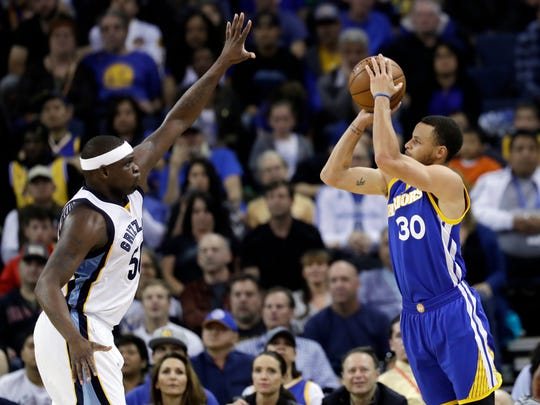 Golden State Warriors' Stephen Curry (30) shoots over Memphis Grizzlies' Zach Randolph during the first half of an NBA basketball game Sunday, March 26, 2017, in Oakland, Calif.