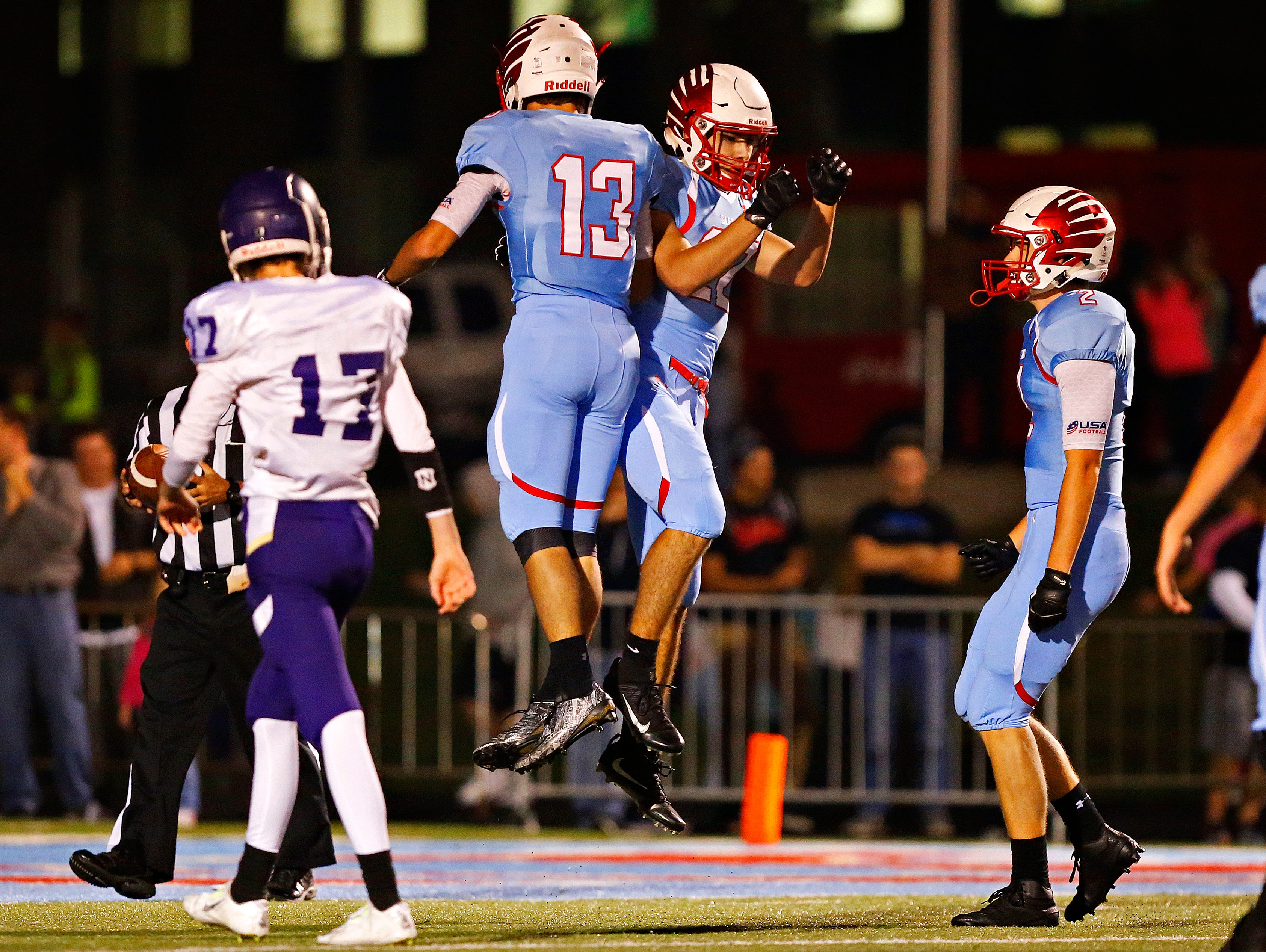 Glendale High School wide receivers Max Nichols (13) and Luke Montgomery (22) celebrate after Montgomery caught a long touchdown pass by quarterback Alex Houston (not pictured) during first quarter action of the game between Glendale High School and Camdenton High School at Lowe Stadium in Springfield, Mo. on Oct. 14, 2016.