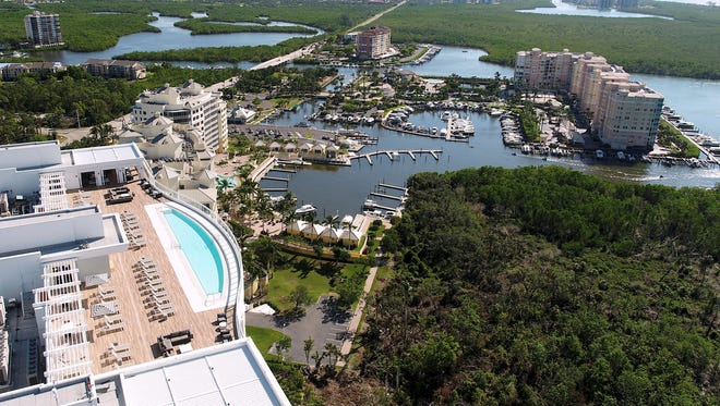 Many of the rooftop amenities on Kalea Bay's first tower (on left) are completed, including the pool and furnished sun deck.