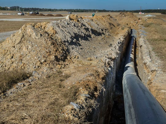 12,000 linear feet of pipe will carry water underground from the quarry to the terminal.  BNA is transforming a 43-acre quarry into a geothermal lake plate cooling system - the largest in North America -- that will reduce electricity usage for BNA. Tuesday Oct. 20, 2015, in Nashville in Tenn.