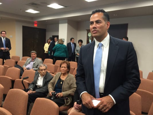 Tommy Gonzalez, with his parents seated at left, was unanimously approved as city manager today by El Paso City Council.