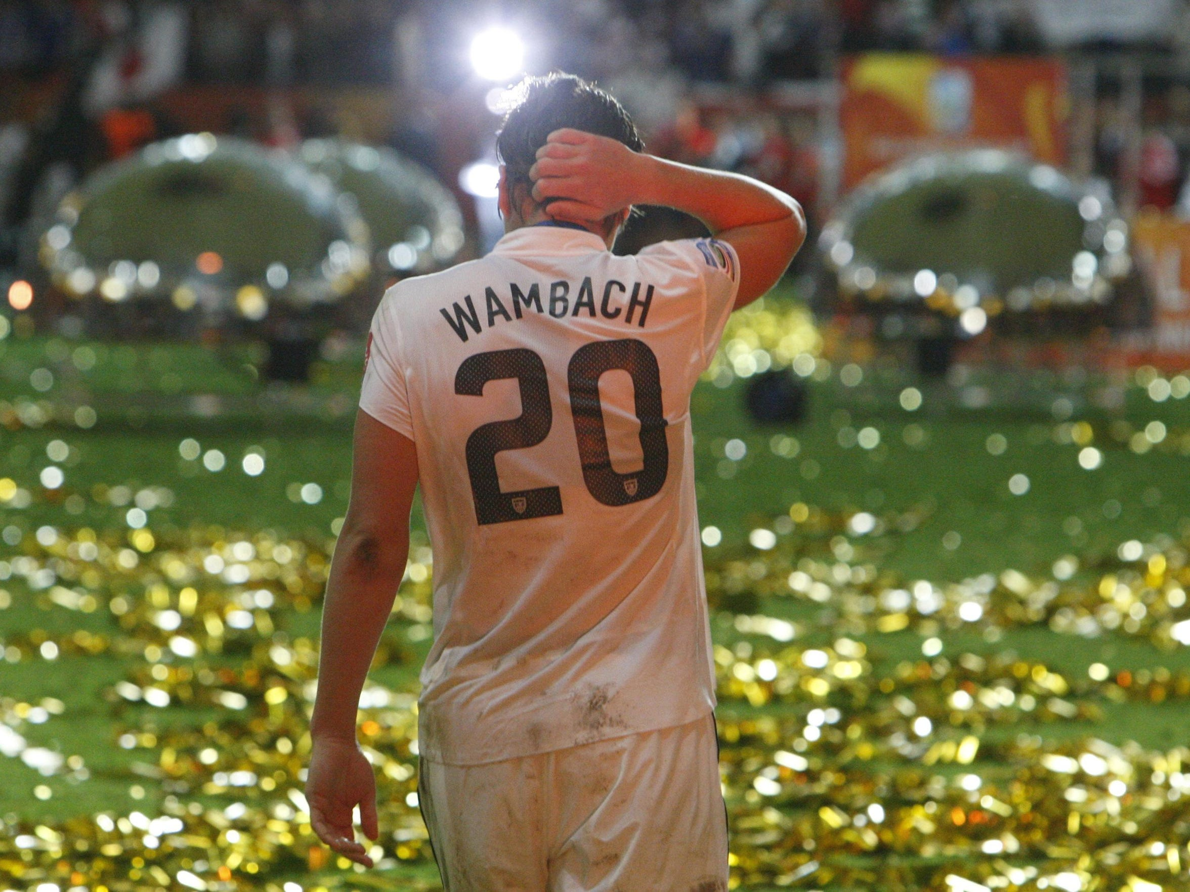 Abby Wambach walks on the field after the U.S. lost the final match against Japan in the 2011 World Cup final.