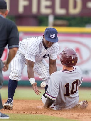 College of Charleston's Ryan Brown steals second against Auburn second baseman Melvin Gray on Sunday.