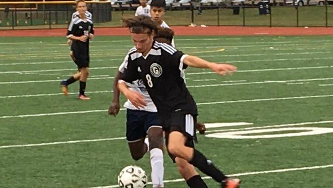 Junior Matt DeGennaro controls the ball in the county preliminaries against North 13th Street.