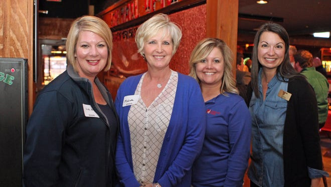From left, Vicki Henson, Chamber executive director,  meets Melinda Shepard, Kelsey Hempel and Monica Gonzalez at Overtime Sports Bar & Grill Thursday for Business After Hours.