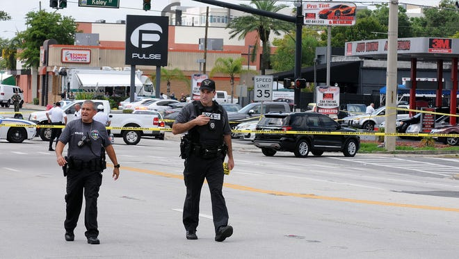 Orlando, Fla., police officers seen outside of Pulse nightclub after a fatal shooting and hostage situation where 50 people died on June 12.