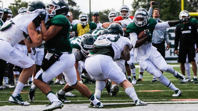 MSU RB LJ Scott runs the ball during football practice Friday, August 4, 2017.  [MATTHEW DAE SMITH/Lansing State Journal]