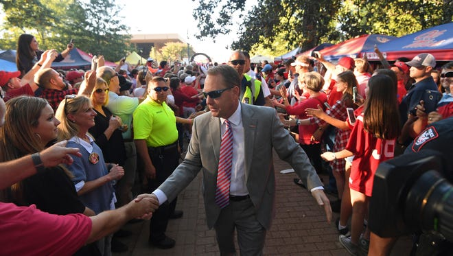 Mississippi head coach Hugh Freeze greets fans during the Walk of Champions before an NCAA college football game against Auburn in Oxford, Miss., Saturday, Oct. 29, 2016. (AP Photo/Thomas Graning)