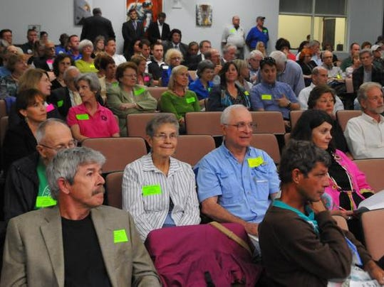 The audience was full of residents wearing green 'protect our lagoon with a stronger fertilizer ordinance' stickers and workers from
