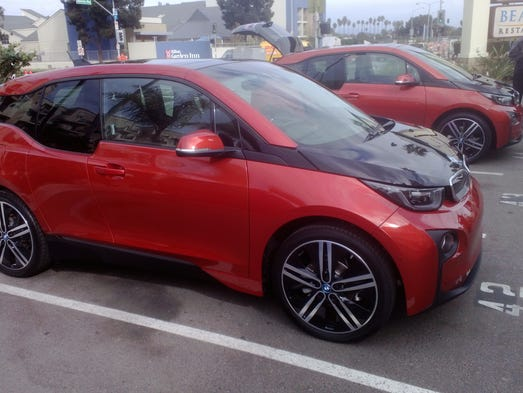 The i3 goes on sale next April on the E. coast, May on the W. coast. Base price is $42,275 including $925 destination and excluding any tax credits. For another $3,850 you can get a range extender – two-cylinder BMW motorcycle engine, to run a generator.