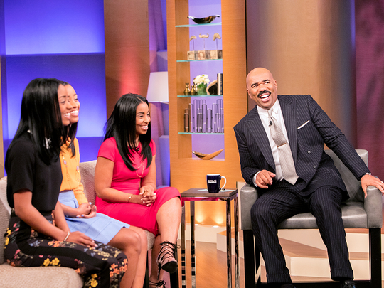 Kaylan Mahomes (from left), sister Kyla Mahomes and mom Tina Brown talk with Steve Harvey about their viral photo.