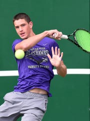Bloomfield Hills sophomore Tommy Herb warms up before a recent OAA Red Division match at Birmingham Groves.
