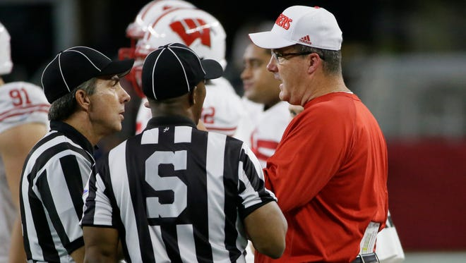 Wisconsin head coach Paul Chryst talks with officials during the second half of an NCAA college football game against Alabama on Sept. 5  in Arlington, Texas.