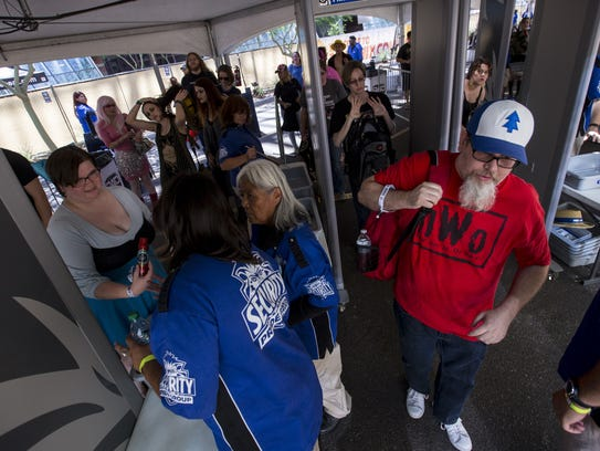 People go through security during Day one of Phoenix