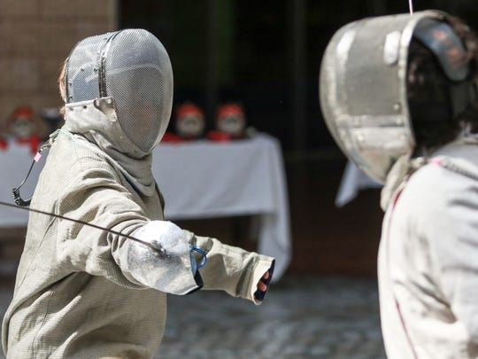 Benton Bresler, 11 (left), competes against Sam Straub, 8, during their sabre fencing matchup during the Coastal Bend Fencing Society mini-tournament Saturday, Oct. 29, 2016, at Sunrise Mall. Sabre fencing only allows for points to be scored on hits to the upper body.