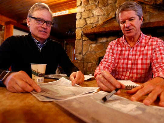 Owner Charles Skinner, left, and project manager Peter Biermeier, show on a map of the future expansion ski area Tuesday at Granite Peak Ski Resort in Rib Mountain.