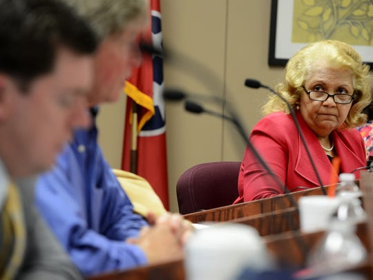 Jackson-Madison County Schools Superintendent Verna Ruffin listens to a question from school board member David Clifft about middle school sports during Monday's board meeting.