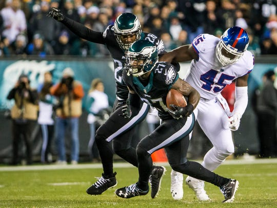 Eagles safety Malcolm Jenkins returns an interception for a touchdown in the first quarter of an NFL game between the Philadelphia Eagles and the New York Giants at Lincoln Financial Field in Philadelphia, Pa. on Thursday night.