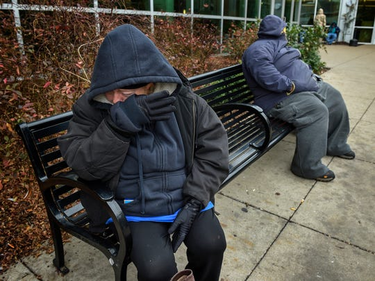 Marilyn Dickerson cries as she waits for her husband outside the Room in the Inn on Wednesday, Dec. 14, 2016, in Nashville. She stayed at the shelter Tuesday night while her husband slept on the street. They have been homeless two weeks after their car was stolen on their move from Jackson, Tenn., to Florida to start a new life.