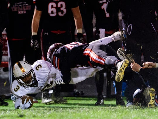 Central's Tre'Jon Evans (3) is tackled by East Central's
