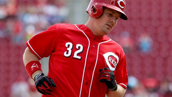 The Reds' Jay Bruce runs the bases after hitting a