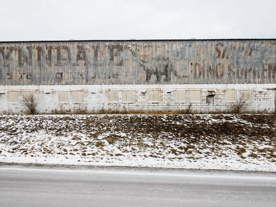 The paint on the side of an old white barn has chipped away revealing a decades-old sign advertising for the now-defunct Lynndale Race Track as seen on Sunday, Jan. 7, 2018. The track operated for several years in the 1960s.