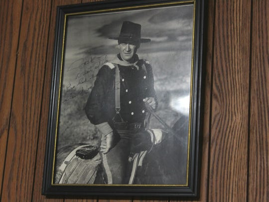 A signed photograph of John Wayne that Jack Barham