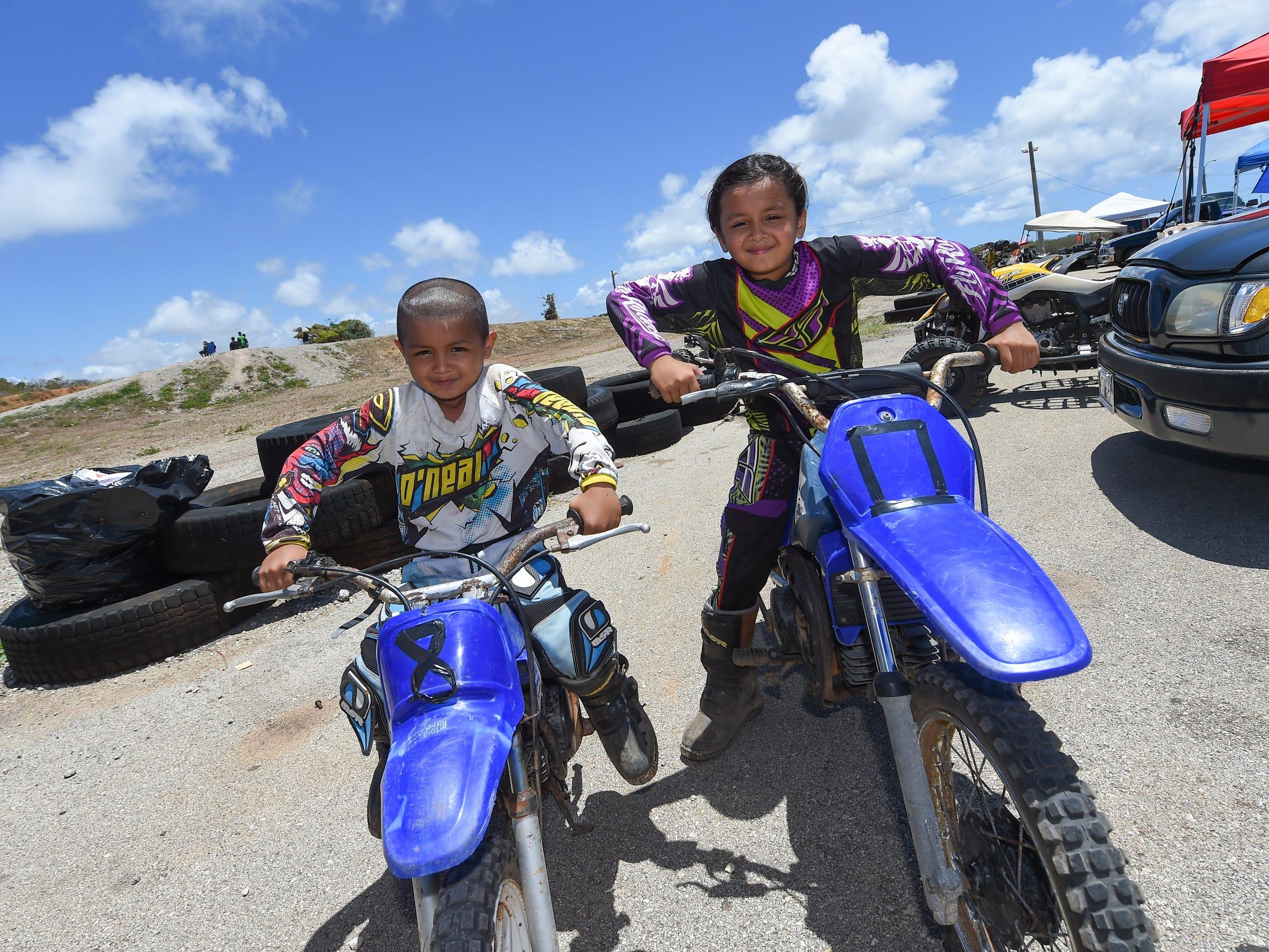 Motocross siblings Jonathan Aguon, 5, left, and his
