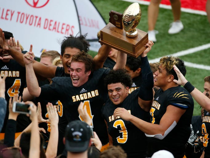 Saguaro celebrates winning the 4A high school football
