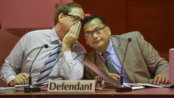 Defendant Michael Elhert, left, leans over to speak to his attorney, Joaquin Arriola Jr., during the first day of his criminal sexual conduct trial at the Superior Court of Guam on Thursday, July 13, 2017.