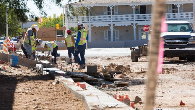 Work continues on the Church and Water Street conversion project on Monday Oct. 23, 2017. Crews are seen working on South Church Street in downtown Las Cruces.