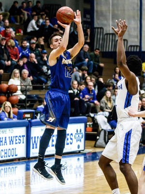 Mukwonago senior Connor Tess (12) goes up for three during the game at Waukesha West on Friday, Jan. 12, 2018.