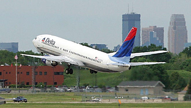 A Delta Airlines jet takes off at Minneapolis/St. Paul International Airport.