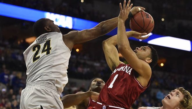 Indiana Hoosiers guard James Blackmon Jr. (1) has his shot blocked by Wichita State Shockers forward Shaquille Morris (24) during the first half in the second round of the 2015 NCAA Tournament at CenturyLink Center.