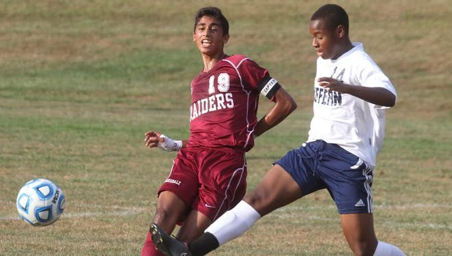 Scarsdale's Fazel Shaikh, left, is pressured by Suffern's William Joiseus during their game at Suffern Sept. 9, 2015. Scarsdale won 1-0.