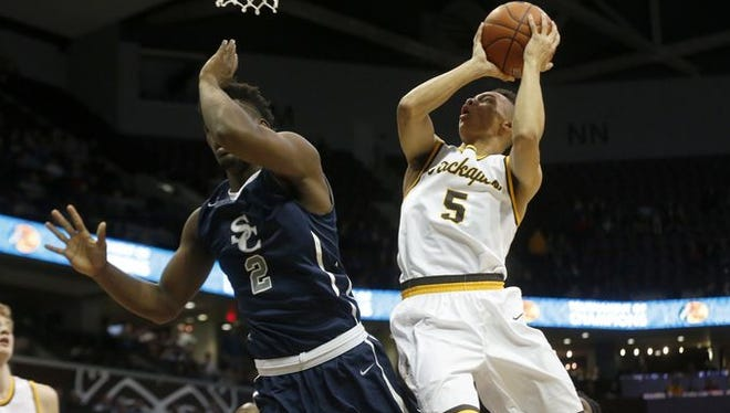 Kickapoo senior Cameron Davis (right) scored 24 points in two losses at the Bass Pro Tournament of Champions at JQH Arena.